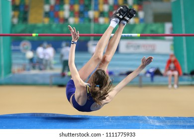 ISTANBUL, TURKEY - MARCH 10, 2018: Undefined athlete high jumping during International U18 Indoor Athletic Match