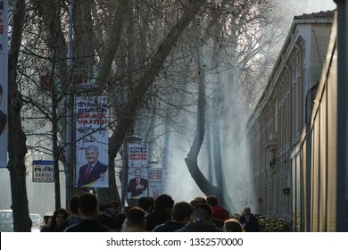 Istanbul, Turkey - March 10, 2019 :  Many people walking under trees and Akp banners at Besiktas District. Municipal elections will be make at The Turkey in March 31.