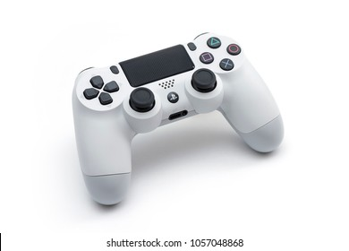 ISTANBUL, TURKEY - MARCH 12, 2018: The new Sony Dualshock 4 white color is on the white background. Sony PlayStation 4 game console of the eighth generation.