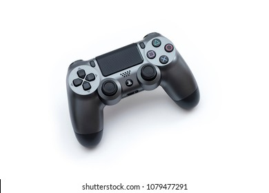 ISTANBUL, TURKEY - MARCH 12, 2018: The new Sony Dualshock 4 gunmetal color is on the white background. Sony PlayStation 4 game console of the eighth generation.