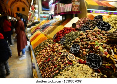 ISTANBUL, TURKEY, MARCH 14, 2019: People walking and shopping inside the Spice Bazaar (Misir Carsisi) one of the largest bazaars in the city. Located in the Eminonu quarter of the Fatih district.