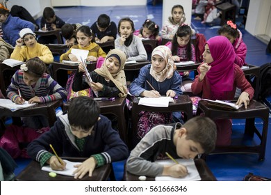 Istanbul Turkey March 16, 2015 Syrian refugees children studying in the classroom. Voluntary Nas?ra Boudeh and her friends educate Syrian refugees children.