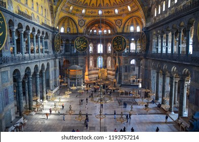 Istanbul, Turkey - March 2012: Scenic view of tourists and visitors inside the Hagia Sophia (Ayasofya). It is the former Greek Orthodox Christian patriarchal cathedral and now a museum in Istanbul.