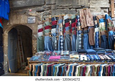 ISTANBUL, TURKEY - MARCH 2012: Scenic view of the Turkish bazaar and clothing stores. Tourists and visitors walking on the narrow pedestrian streets in Istanbul, Turkey
