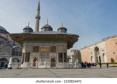 Istanbul - Turkey: March 2019. The Fountain of Sultan Ahmed III in front of the Topkapi Palace. Ottoman style buildings in Istanbul.