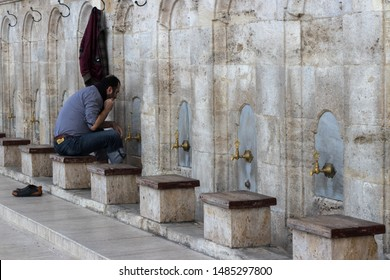 Istanbul - Turkey: March 2019. Muslim man taking ablution in Fatih mosque. Ablution or wudu is islamic ritual.