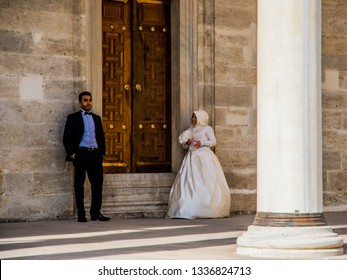 Istanbul, Turkey - March 21 2014: Turkish bride couple taking wedding photo in the forecourt of the Blue Mosque