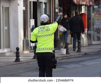 Istanbul, Turkey. March 22 2019. A traffic police officer directing traffic in the city in morning rush hour