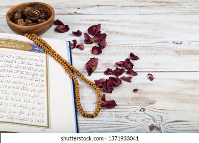 Istanbul / Turkey - March 22, 2019 ;Holy book quran for Muslims holiday, Ramadan,blessed Friday.Koran,date ,dried roses and rosary bead for Islamic concept.