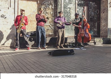 Istanbul, Turkey - March 23, 2011: Street musicians performing with their instruments in Istiklal Avenue, Istanbul. The avenue is a popular spot for locals and tourists with its 24/7 vivid lifestyle.