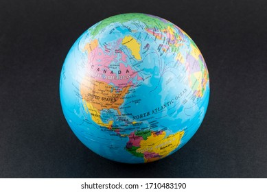 ISTANBUL, TURKEY - MARCH 30, 2020. Reduced model of the Earth World globe atlas on the black background.