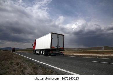 Istanbul, Turkey - March 31 2019 : Truck driving on the asphalt road in rural with clouds.