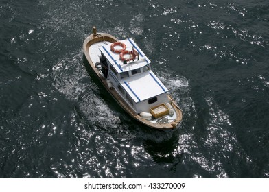ISTANBUL, TURKEY - MAY 04, 2009: A small boat sailing on the Bosphorus river in Istanbul