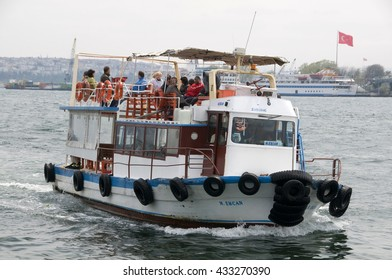 ISTANBUL, TURKEY - MAY 04, 2009: Boat with tourists sailing on the Bosphorus river