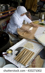 ISTANBUL, TURKEY - MAY 04, 2009: A woman making bread in a restaurant