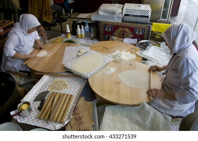 ISTANBUL, TURKEY - MAY 04, 2009: Muslim women preparing bread