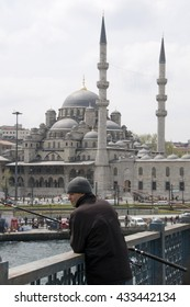 ISTANBUL, TURKEY - MAY 04, 2009: Angler on the Galata Bridge and view of the New Mosque