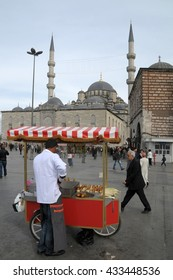 ISTANBUL, TURKEY - MAY 04, 2009: Peddler in Eminonu and view of the New mosque , also known as Yuni, Istanbul