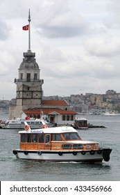 ISTANBUL, TURKEY - MAY 04, 2009: A boat sails against Leandro Tower on the Bosphorus river in Istanbul