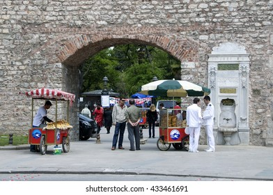 ISTANBUL, TURKEY - MAY 04, 2009: People and hawker food at one of the gates of the Gulhane Park Istanbul