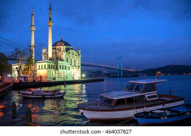 ISTANBUL, TURKEY - MAY 04, 2009: Small boats on the Bosphorus river and Ortakoy Mosque at dusk