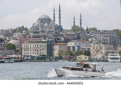 ISTANBUL, TURKEY - MAY 04, 2009: Passenger boat sailing on the Bosphorus river, with Suleymaniye mosque as the background