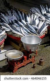 ISTANBUL, TURKEY - MAY 04, 2009: Balance and baskets of fish, in a market fishing port , in the neighborhood of Eminonu