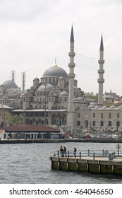 ISTANBUL, TURKEY - MAY 04, 2009: Pier on the Bosphorus river and view of the mosque in Yeni Camii