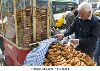 ISTANBUL, TURKEY - MAY 04, 2009: A man selling bread in the streets of Eminonu, with a cart