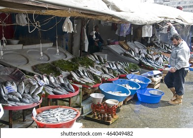 ISTANBUL, TURKEY - MAY 04, 2009: Fishmonger in front of his shop in the market fishing district of Eminonu