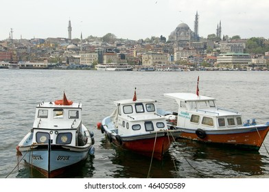 ISTANBUL, TURKEY - MAY 04, 2009: Boats docked in a small port of Eminonu , overlooking mosques
