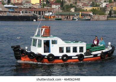ISTANBUL, TURKEY - MAY 04, 2009: Tourists riding in a boat on the Bosphorus river