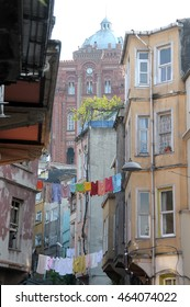 ISTANBUL, TURKEY - MAY 04, 2009: Houses with clothes hanging in a neighborhood of the city and orthodox style building background
