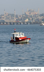 ISTANBUL, TURKEY - MAY 04, 2009: Bosphorus boat on the river with the city in the background
