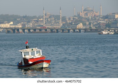 ISTANBUL, TURKEY - MAY 04, 2009: Small boat on the waters of the Bosphorus at sunset