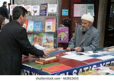 ISTANBUL, TURKEY - MAY 05, 2009: Seller of religious books at the door of the mosque of Sultan Eyup Camii