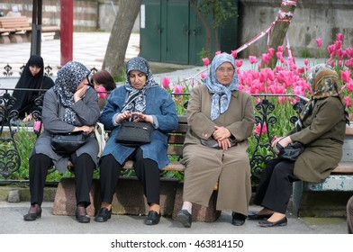 ISTANBUL, TURKEY - MAY 05, 2009: Group of Muslim women, sitting in a square in the Eyup Sultan Mosque