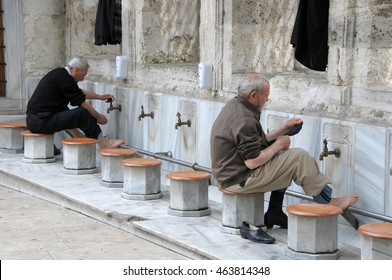 ISTANBUL, TURKEY - MAY 05, 2009: Men washing feet before entering Eyup Sultan Mosque