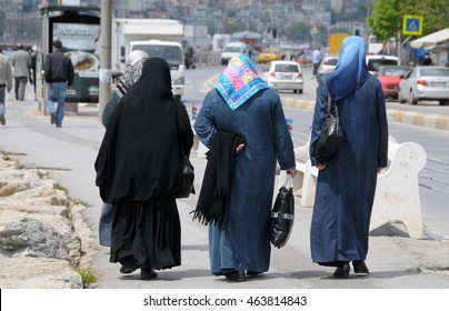 ISTANBUL, TURKEY - MAY 05, 2009: Muslim women walking on a city street