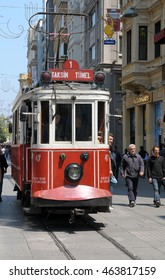 ISTANBUL, TURKEY - MAY 05, 2009: Nostalgic tram , crossing streets near Taksim Square
