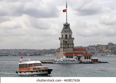 ISTANBUL, TURKEY - MAY 05, 2009: A passenger boat crossing near Leandro Tower on the Bosphorus river
