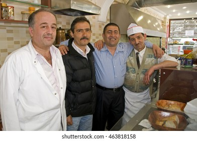 ISTANBUL, TURKEY - MAY 05, 2009: Waiters and chef of a restaurant near the Blue Mosque