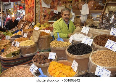 ISTANBUL, TURKEY - MAY 05, 2009: Nut seller in a shop Grand Bazaar