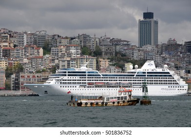ISTANBUL, TURKEY - MAY 05, 2009: Cruise ship docked at one of the piers of the Bosphorus river, with the view of the city