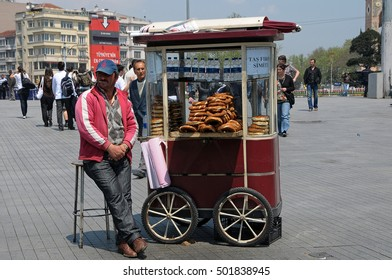 ISTANBUL, TURKEY - MAY 05, 2009: Peddler, with bread trolley in Taksim Square