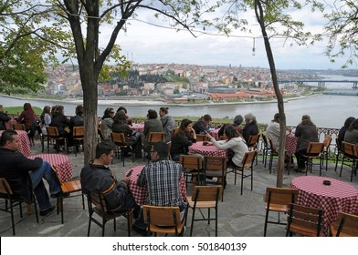 ISTANBUL, TURKEY - MAY 05, 2009. People sitting on the terrace of the Pierre Loti cafe, overlooking the Golden Horn