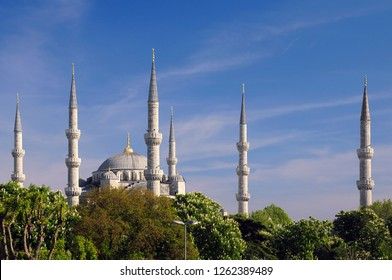 ISTANBUL, TURKEY - MAY 1, 2012: Blue mosque with its six minarets and chestnut trees against the blue sky background in the springtime