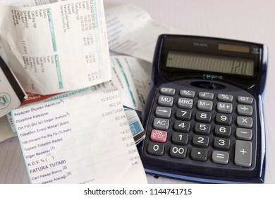 Istanbul / Turkey -May 1, 2018 ; calculator and bills on the white background.the house account does not fit the bazaar.