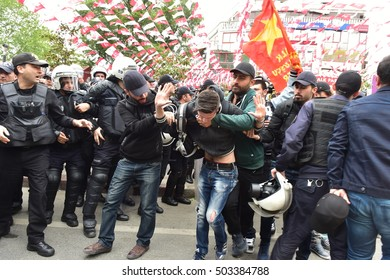 ISTANBUL, TURKEY - MAY 1: International Workers Day. Turkish Police Officers detain a protester on May 1, 2016 in Istanbul,