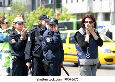 ISTANBUL, TURKEY - MAY 1: International Workers Day. Police officers exposed to tear gas on May 1, 2007 in Istanbul, Turkey. Taksim Square is the center of the protest and celebrations.